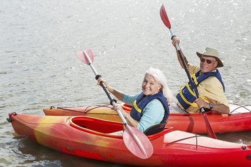 Active senior couple with kayaks.